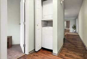 Stacked Washer and Dryer in hall closet.
