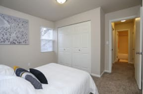 Bedroom with full side bed and 2 panel closet doors