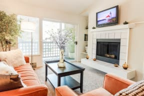Kent Apartments - Signature Pointe Apartment Homes - Living Room, Deck, and Fireplace