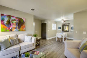 Vista Promenade Apartments in Temecula - Living Room with Stylish Decor, Hardwood Floor , Beige Walls and Cozy Fire Place