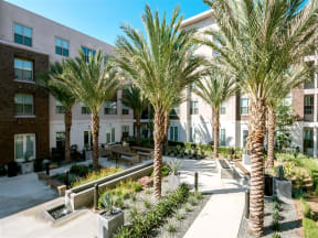 Pomona CA Apartments for Rent - Exterior View of Monterey Station's Building Showing Expansive Community and Parking Lot
