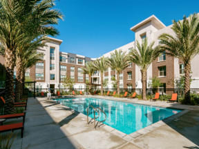 Pomona CA Apartments - Sparkling Resort Style Pool Featuring Various Lounge Areas
