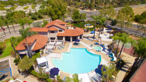 Apartments in Temecula, CA - Vista Promenade Sparkling Swimming Pool Surrounded By Lush Landscaping and Lounge Seating