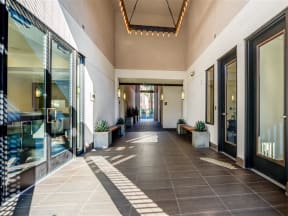 Pomona CA Apartments for Rent - View of Monterey Station's Building Showing Expansive Interior Hallway