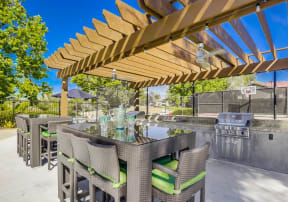 Temecula Apartments for Rent - Vista Promenade BBQ Area with Grills, Covered Patio, Modern Patio Furniture, and Ceiling Fan