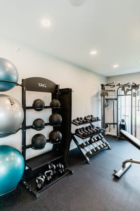 Free Weights In Gym at Deer Run Apartments, Brown Deer
