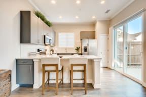 Fitted Kitchen With Island Dining at Avilla Reserve, Texas, 76247
