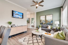 Living Room With Television at Avilla Heritage, Grand Prairie, Texas