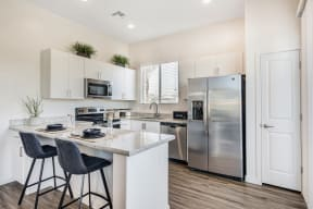Fitted Kitchen With Island Dining at Avilla Gateway, Phoenix, 85037