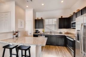 Fitted Kitchen With Island Dining at Avilla Northside, Texas, 75071