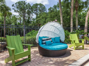 Granite at Porpoise Bay Apartments Daytona Beach pool deck seats