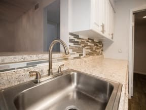 granite at porpoise bay apartments daytona model unit kitchen sink closeup