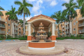 Shamrock of Sunrise Apartments Front Portico and Fountain