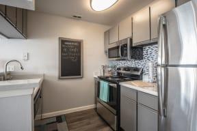 stainless steel renovated kitchen large sink wood floor orlando apt