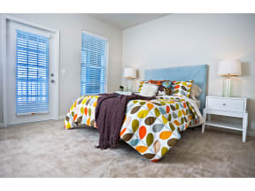 Bedroom With Expansive Windows at The Residence at Marina Bay, South Carolina