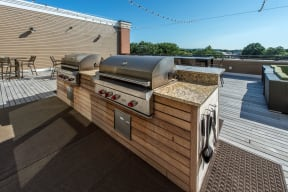 Grills on community roof deck | The Merc at Moody and Main