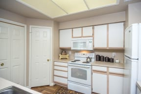 Kitchen with white appliance package   Sedona Springs