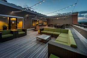 Outdoor couches on community roof deck | The Merc at Moody and Main