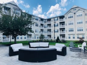 Outdoor patio with lounge seating  | Highlands at Faxon Woods