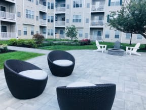 Community patio and lounge area  | Highlands at Faxon Woods