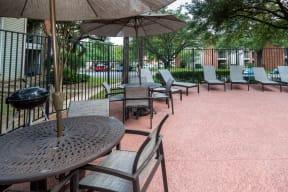 Poolside lounge area | Village Oaks