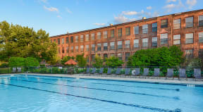 Pool with lounge chairs  | Bigelow Commons
