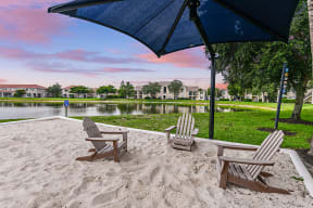 Relax in the adirondack chairs by the water