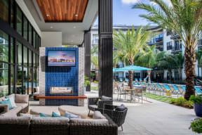 Outdoor lounge area with TV  | District at Rosemary