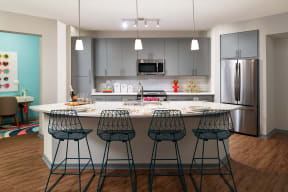 Kitchen with island  | District at Rosemary