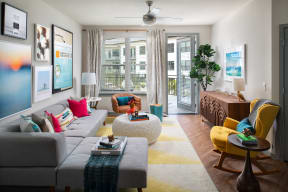 Living room with patio access  | District at Rosemary