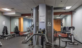 Fitness center features cardio equipment and free weights |Residences at Manchester Place