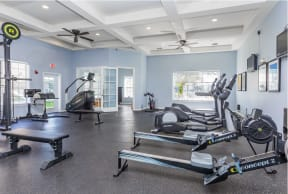 Fitness center with cardio machines   Cypress Legends