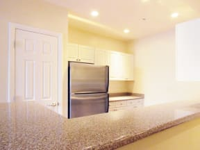 Kitchen with granite countertops  | Highlands at Faxon Woods