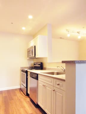 Signature style kitchens include stainless appliances and white cabinets  | Highlands at Faxon Woods