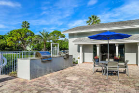 Poolside patio with grills   Jupiter Isle