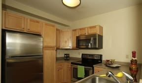 Kitchen appliances include range, refrigerator, dishwasher, and microwave |Residences at Manchester Place