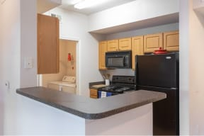 Updated Kitchen With Black Appliances  Cypress Legends