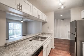 Kitchen with Stainless Steel Appliances  | Lakes at Suntree