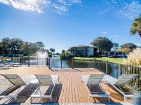 Lounge in the sunshine on the deck | Lakes at Suntree