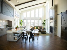 indoor clubhouse seating with floor to ceiling windows