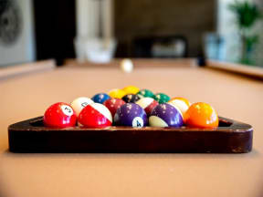 close up of racked pool balls on pool table
