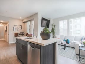 kitchen island with dishwasher and sink