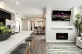 open kitchen to living room featuring fireplace