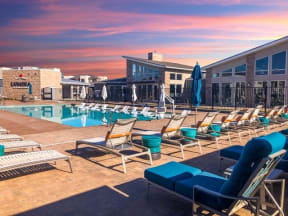 pool and lounge chairs at sunset