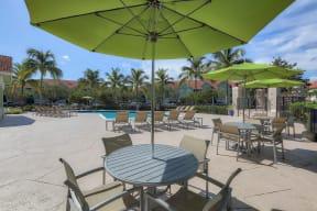 Poolside tables and umbrellas  | Monterra at Bonita Springs
