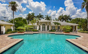Pool and clubhouse | Promenade at Reflection Lakes apartments in Fort Myers