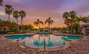 Dusk view of community pool | Promenade at Reflection Lakes