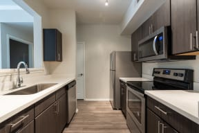 Kitchen with stainless steel appliances | River Stone Ranch