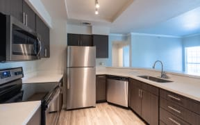 Kitchen with stainless steel appliances   Sedona Springs