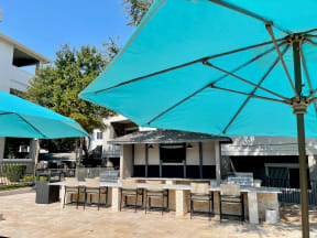 Outdoor lounge with gas grills   Stonelake at the Arboretum
